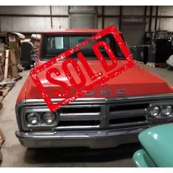 Orange 1972 GMC Genuine big block truck